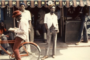 Gregory Isaacs in front of his African Museum store on Chancery Lane, Kingston